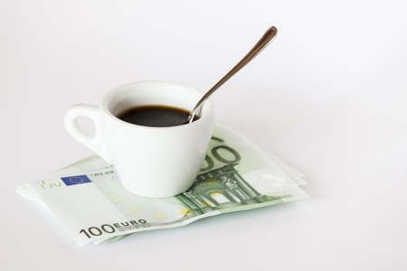 Coffee cup on money