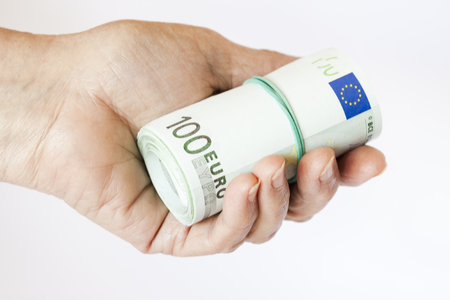 Roller of banknotes in the hand