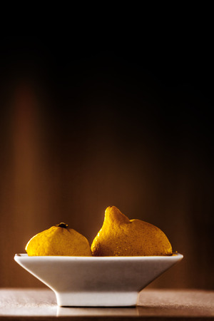 Two halfs of a lemon on a little cup Stock Photo