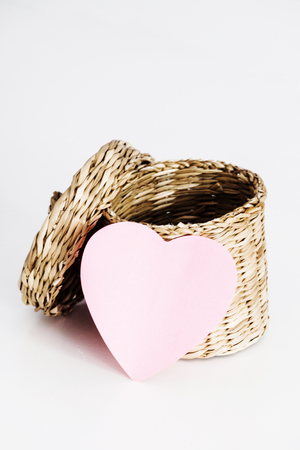 Empty straw basket with pink heart