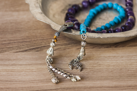 Muslim rosary necklaces on a zink pot