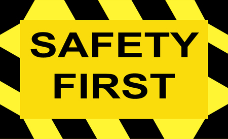 A sign with the write Safety first; yellow background and black-yellow striped border - vector