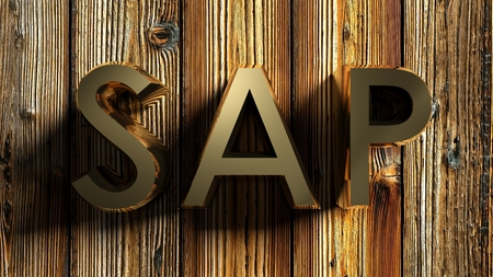 SAP brass write on raw wooden background - 3D rendering Фото со стока