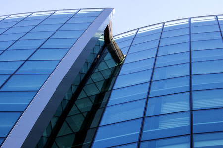 Modern straight and curved architectural lines of the facade of a building - photography