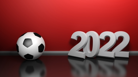2022 at red wall with soccer ball - 3D rendering illustration Фото со стока