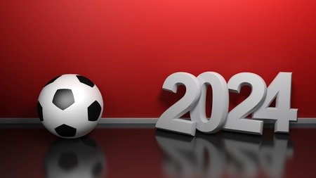 2024 at red wall with soccer ball - 3D rendering illustration
