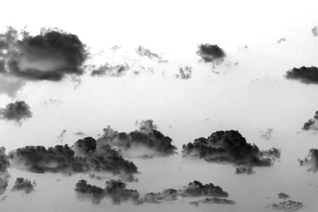 Abstraction of clouds flying like ghosts in the sky - black and white photograph