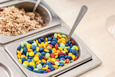 smarties: containers with cereals and smarties