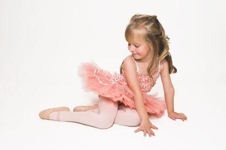 ballerina tights: Young ballet dancer wearing an apricot tutu