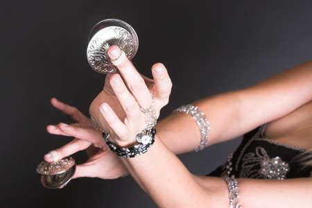 belly dancer: Belly Dancer hands holding Tribal Zagat or finger symbols