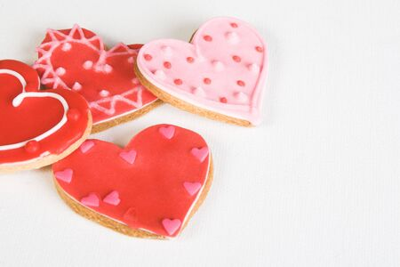 heart shaped: Red and Pink Heart Shaped Cookies with Icing Stock Photo