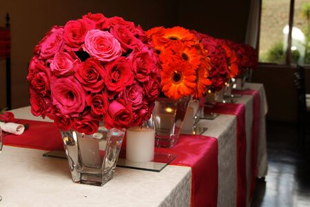 Orange and pink Wedding flowers on the main table Stock Photo - 2587257