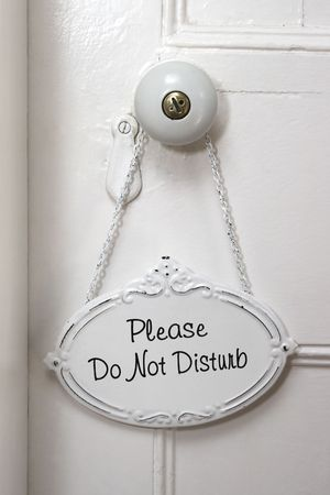A Do No Disturb sign on a white door Stock Photo