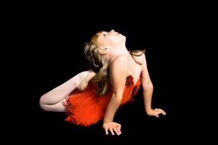 ballerina tights: Young ballet dancer wearing a red costume Stock Photo