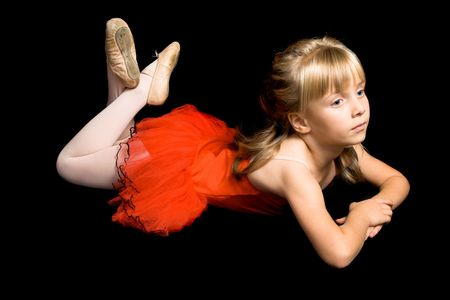 Young ballet dancer wearing a red costume photo