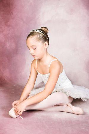 tying: Young dancer wearing a tutu and tiara Stock Photo