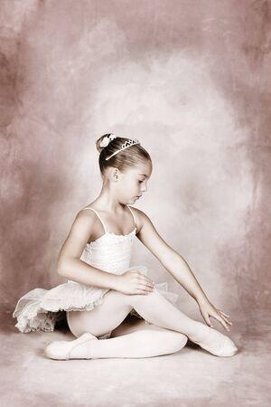 ballerina tights: Young dancer wearing a tutu and tiara Stock Photo