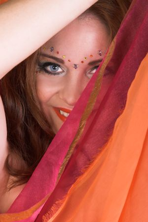 belly dancer: Belly Dancer wearing a red costume with jewelery