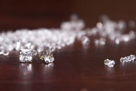 fake diamond: Diamond Earrings amongs glass stones that look like diamonds