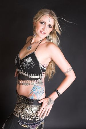 belly dancer: Beautiful Blond Belly Dancer with traditional jewelery Stock Photo