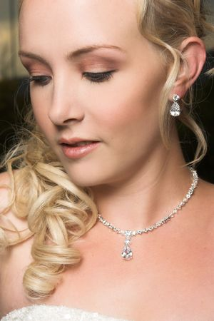earring: Beautiful Blond bride wearing diamond jewelery