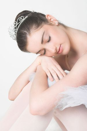 Dreaming ballerina resting her head on her knees photo