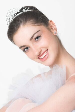 Fairytale Ballerina wearing a white tutu and tiara photo