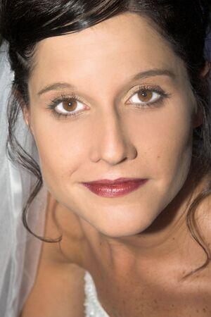eyes hazel: Beautiful brunette bride with hazel eyes, close up Stock Photo