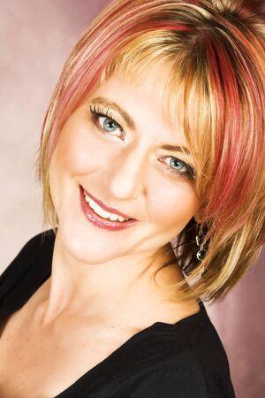 blond streaks: Beautiful blond female with red streaks in her hair