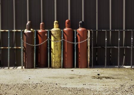 propane tank: Securely Stored & Chained Industrial Gas Bottles Stock Photo