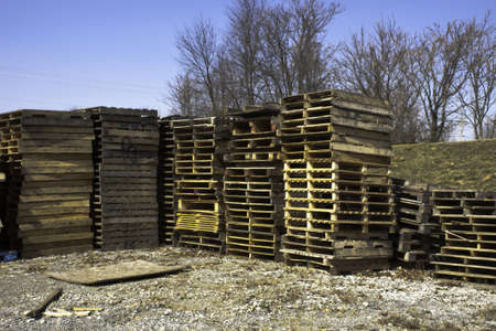 on the skids: Stacked wood skids in a parking lot
