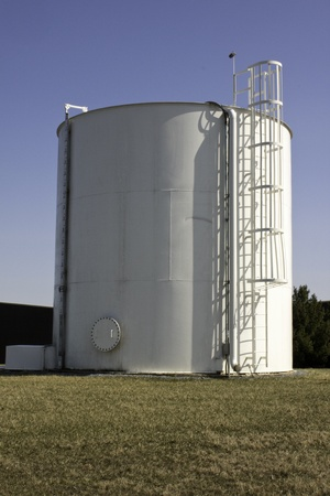 cylindrical: White Water Tank with ladder on a blue sky Stock Photo