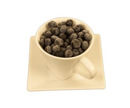 cream colored: Ripe blueberries in a cream colored square & round cup