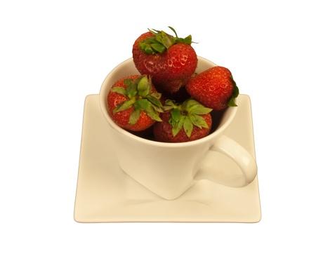cream colored: Ripe strawberries in a cream colored squareround cup