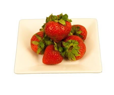 cream colored: Red Strawberries on a cream colored dish