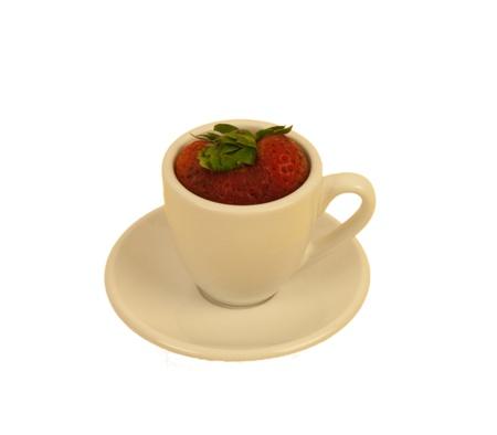 cream colored:  A strawberry filling a cream colored demitasse cup