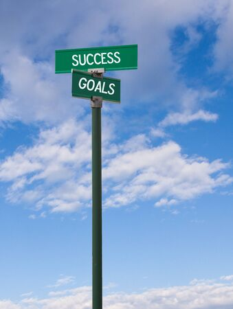 The intersection of success   goals street sign photo