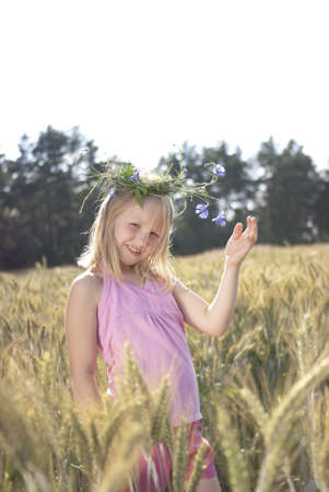 Little girl in the wreath in head Stock Photo - 10019474
