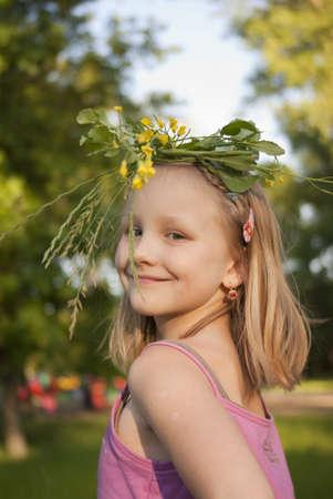 Little girl in the wreath in head Stock Photo - 10674720