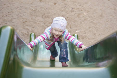 Happy girl  climbing on children Stock Photo - 10674716
