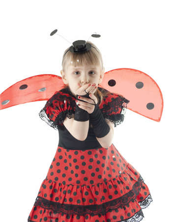 Girl in ladybug costume on white background giving a kiss photo