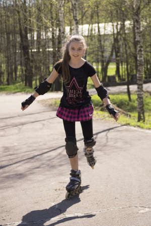 Young girl  skating on Roller Skates outdoor at nature photo