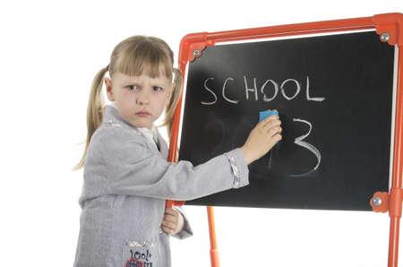 unwillingness: Sad schoolgirl erasing 2013 friom board