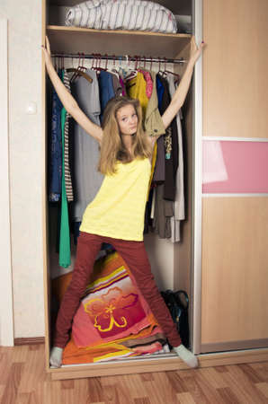 teenage girl in wardrobe at home Stock Photo - 17213784