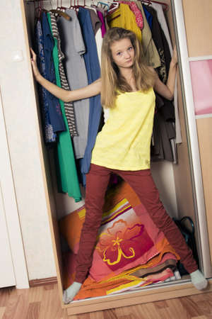 teenage girl in wardrobe at home photo