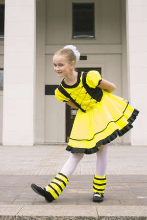 little girl dancing in bee costume photo