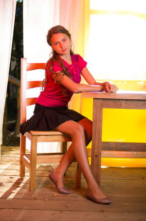 young girl sitting in summer inside pavilion photo
