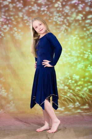 A Happy Dancer Teen Girl Poses in Blue Dress Dance Costume photo