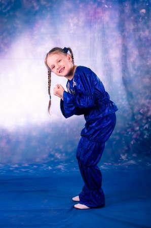 stared: pretty little girl dancing in the blue stared costume in studio Stock Photo