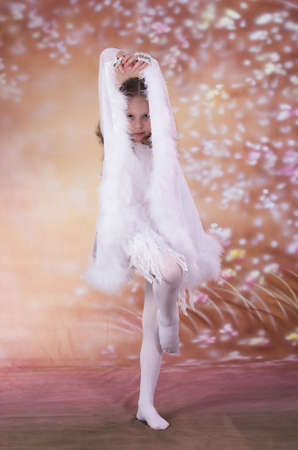 young girl in long white dress with long hair in  the dance pose Stock Photo